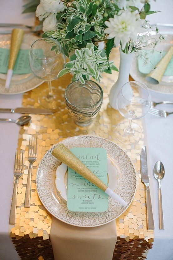 Gold and mint place setting