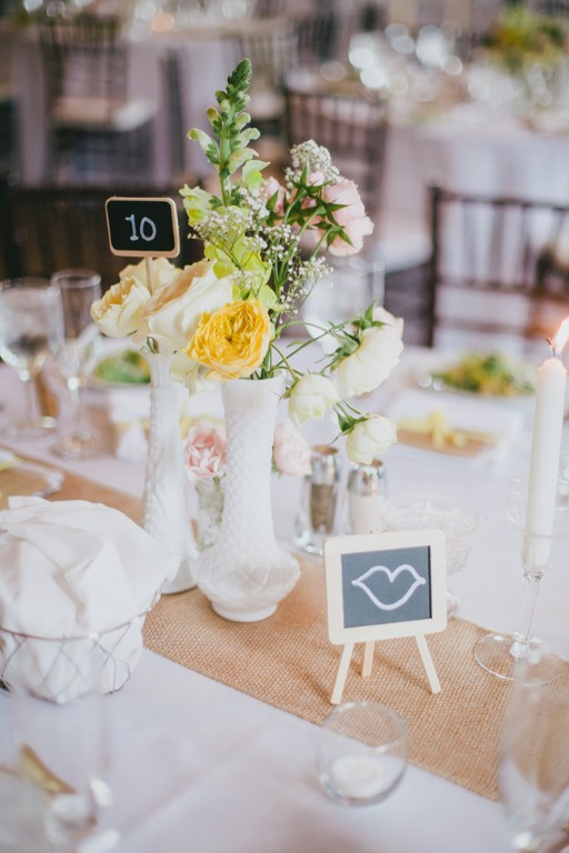 Centerpieces with milk vase-blovelyevents.com