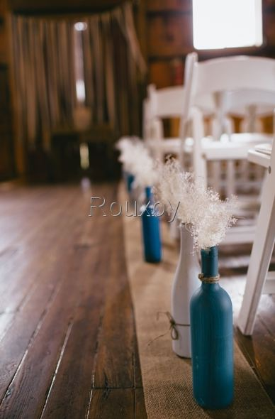 Ailse decor with painted wine bottles, burlap and dried baby's breath