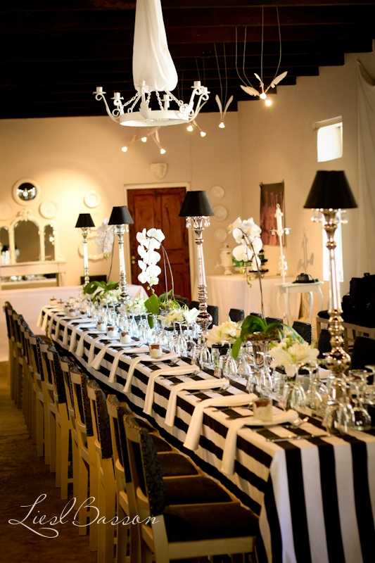 black and white tablescape with orchids and silver mercury lamps