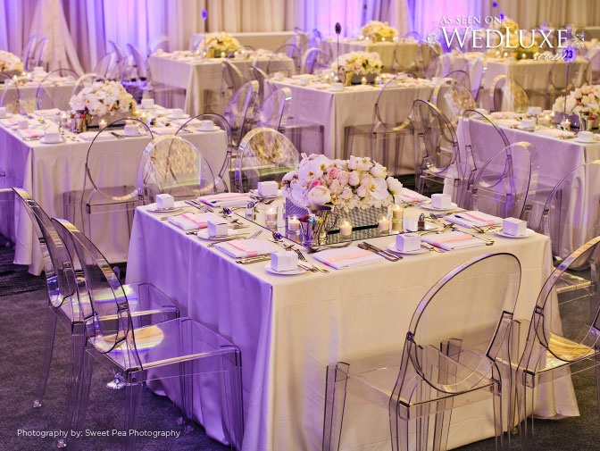 Modern Gliz table with pink centerpieces and ghost chairs