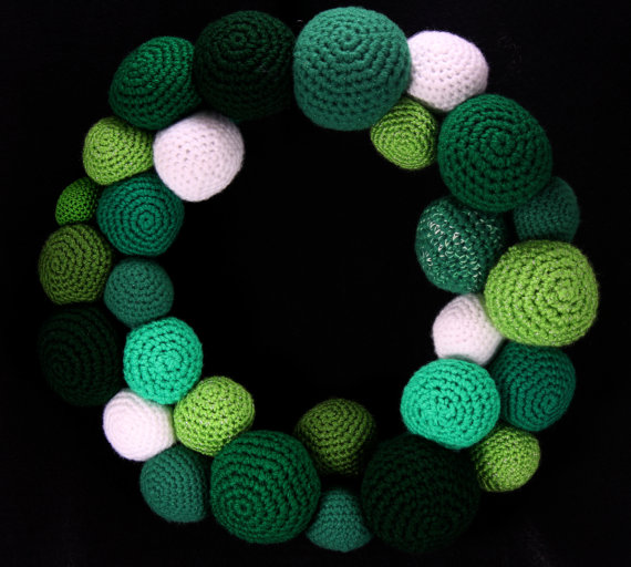 St. Patricks Day wreath decorated with knit balls