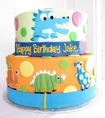 Two tier cartoon dinosaur cake for kids