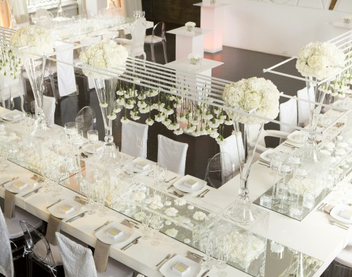 all white modern and chic tablescape and room look. Love that floral!
