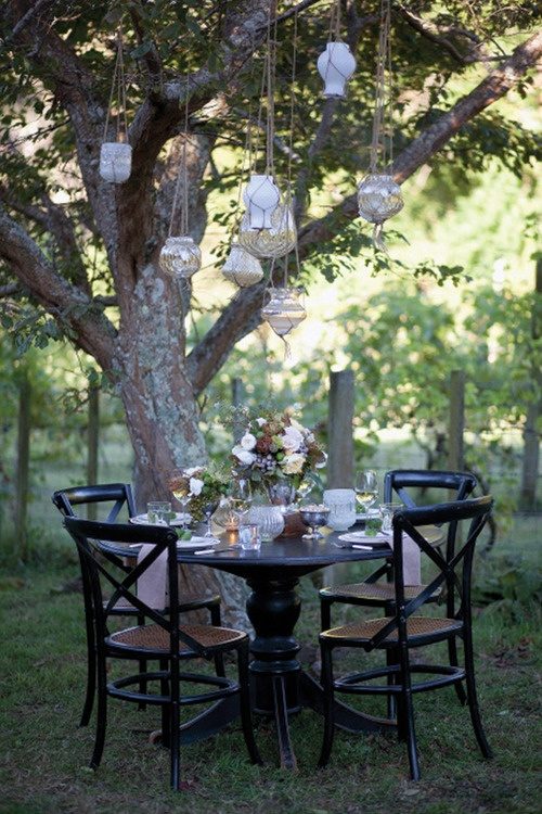 eclectic brown and cream backyard tablescape