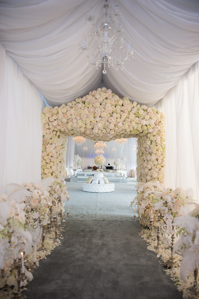 Amazing tent entrance decorated with flowers!