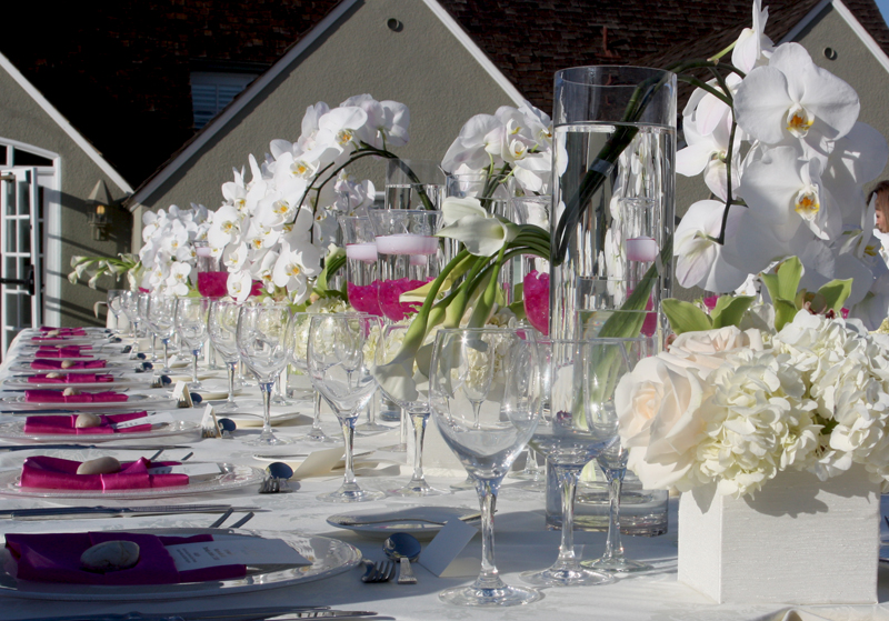 beach wedding tablescape with white orchids and lilys