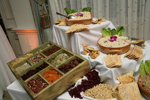 Hummus food bar with assorted breads and crackers for house party