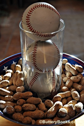 Peanuts and baseballs go perfect for a baseball centerpiece!