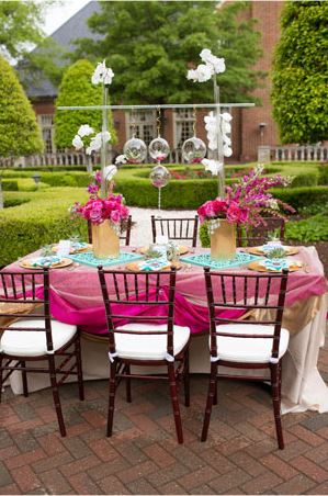 Pink and teal modern wedding tablescape