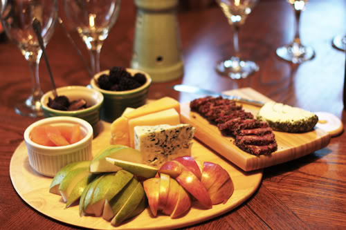 Wine and cheese with apples and nuts for a dinner party