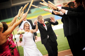 Baseball wedding exit with mini bats!